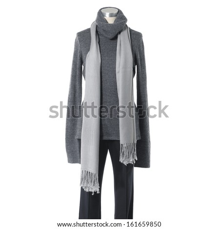 Mannequin female gray dressed with scarf in trousers on white background
