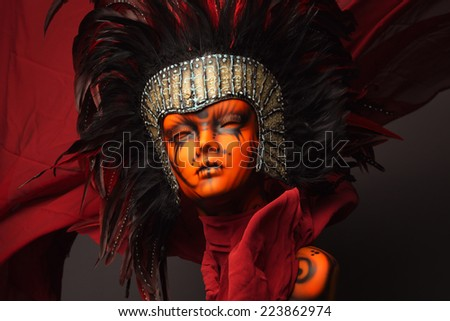 Mannequin girl with ethnic head wear on red background