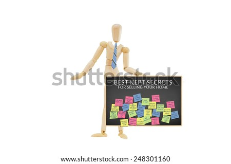 Mannequin holding blackboard filled with post it notes on Best Kept Secrets for selling your home isolated on white background - stock photo