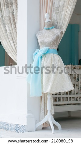 Mannequin in a vintage ivory dress in a sewing workshop, French Provence style - stock photo