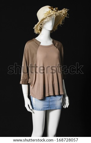 mannequin in female dress with hat and shorts �black background