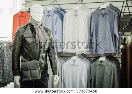 Mannequin in interior of upscale men's clothing store - stock photo