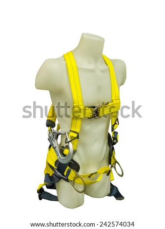 Mannequin in safety harness equipment on a white background - stock photo
