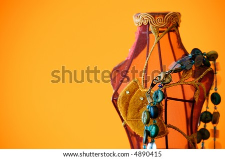 mannequin made of wire and clothes with blue necklace. - stock photo