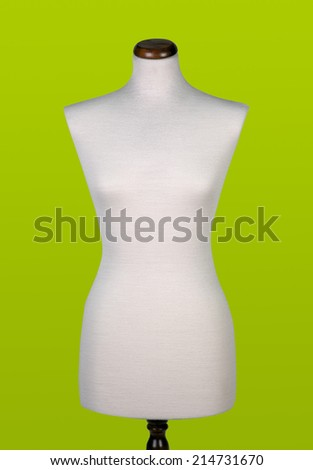 Mannequin or dressmakers dummy on yellow-green background. - stock photo