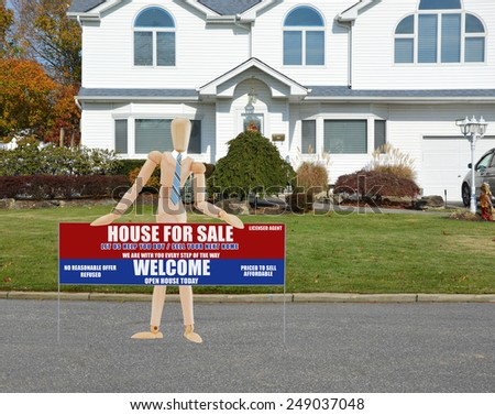Mannequin wearing blue tie holding Real estate for sale open house welcome sign closeup of suburban mcmansion autumn day residential neighborhood USA - stock photo