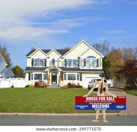 Mannequin wearing red tie holding Real estate for sale open house welcome sign Suburban McMansion home autumn day blue sky residential neighborhood USA - stock photo