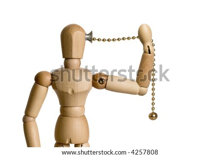 Mannequin with a pull chain switch attached to the side of his head.  The mannequin is pulling the chain to self activate.  Conceptual image for the big idea, motivation, empowerment, etc.