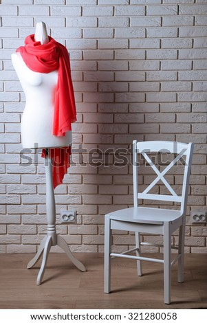 Mannequin with cloth in room - stock photo
