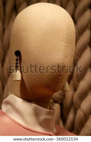 mannequin with earrings