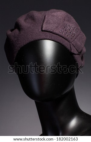 Mannequin with hat and scarf.