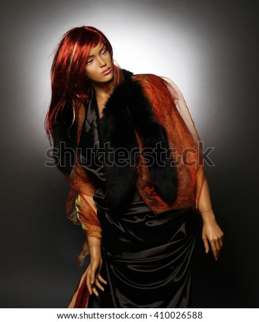 mannequin with red hair, studio shot - stock photo