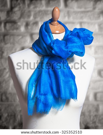Mannequin with silk cloth. Knitted fashion blue organza shawl on tailor bust - stock photo