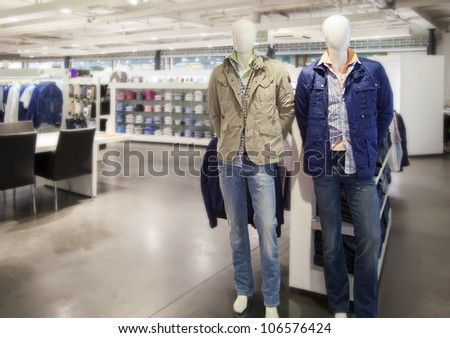 mannequins ( dummies) in modern store - stock photo