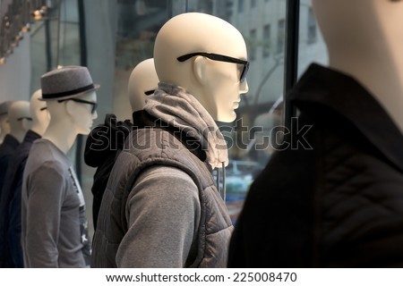 mannequins in a storefront window - stock photo
