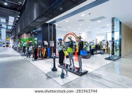 mannequins in fashion shop display window - stock photo