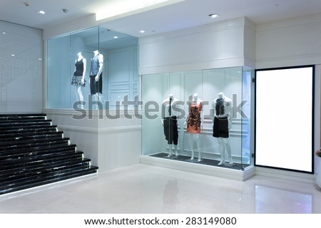 mannequins in shopfront - stock photo