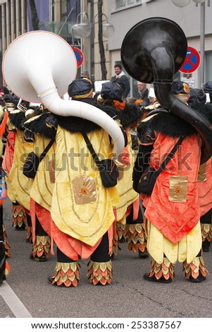 Mannheim, Germany - February 15, 2015: Fastnachtsumzug - carnival parade - traditional public event in the streets of Mannheim drew a crowd of 300.000 viewers. Two tuba players