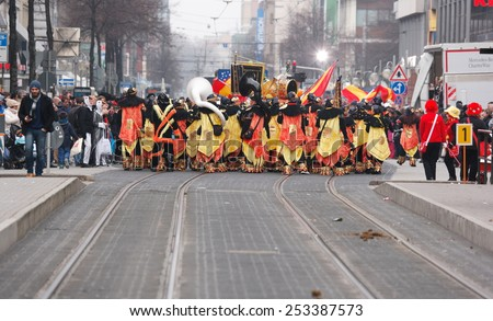 Mannheim, Germany - February 15, 2015: Fastnachtsumzug - carnival parade - traditional public event in the streets of Mannheim drew a crowd of 300.000 viewers. View of parade from behind.