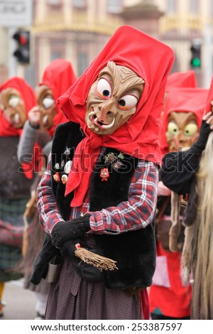 Mannheim, Germany - February 15, 2015: Fastnachtsumzug - carnival parade - traditional public event in the streets of Mannheim drew a crowd of 300.000 viewers. Traditional wooden masks.