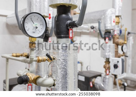 Manometer and heating pipelines - stock photo