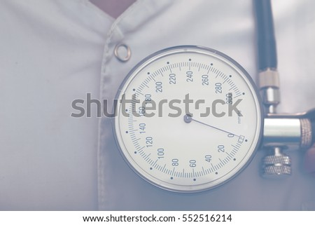 Manometer on a background of white coat of doctor.