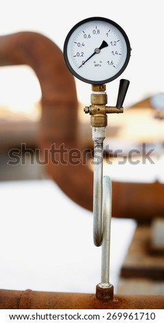 manometer on the old rusty pipe close up - stock photo