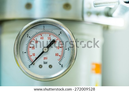 manometer turbo pressure meter gauge in pipes oil plant with liquid inside - stock photo