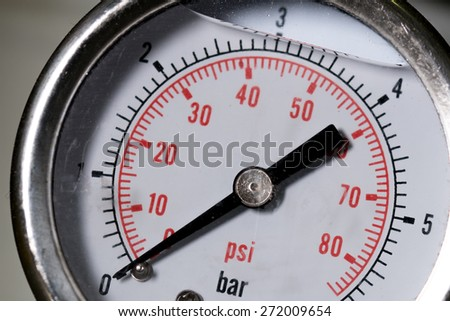 manometer turbo pressure meter gauge in pipes oil plant with liquid inside