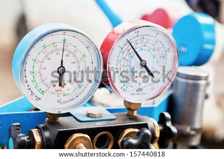 manometers on equipment for filling automotive air conditioners - stock photo