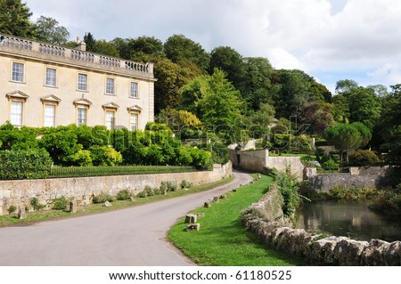 Manor House by a Country Road and River - stock photo