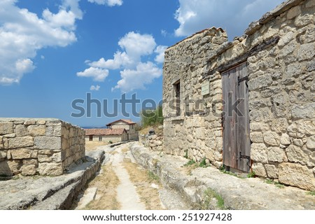 Manor Solomon Bame (Chal-Boryu, Gray Wolf) XVIII century in medieval cave city-fortress Chufut-Kale, main street, Bakhchysarai, Republic of Crimea, Russia - stock photo