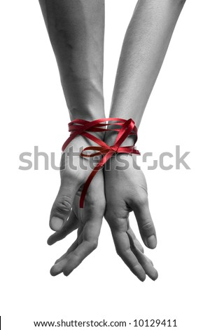 mans and  girls hands tieing with ribbon - stock photo