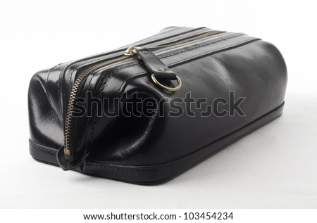 Mans black leather cosmetic toiletry accessory bag or pouch isolated on white background with copy space. - stock photo