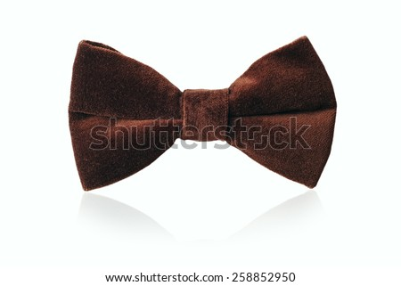 Mans brown velvet bow tie for evening wear or a gentlemans attire, standing upright on white - stock photo