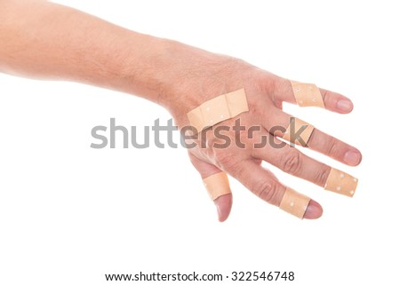 mans hand glued a lot of medical plaster on the elbow, isolated on white, concept first aid and wounds - stock photo
