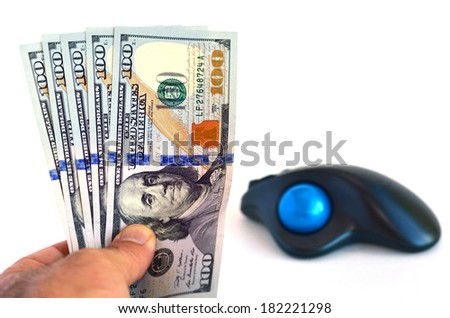 Mans hand holds one hundred (100) US Dollars banknotes against computer mouse isolated on white background. Money Concept of online internet banking, trade and credit. - stock photo