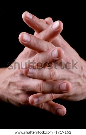 mans hands linked together