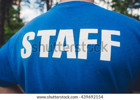 mans inscription on shoulders -  staff - stock photo