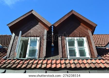 Mansard windows in a old style roof in Tallinn, Estonia. - stock photo