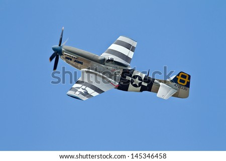 MANSTON, UK - JUNE 22: A preserved USAF P51 Mustang 'Jumpin Jacques' in preparation before giving an air display at the South East Airshow on June 22, 2013 in Manston