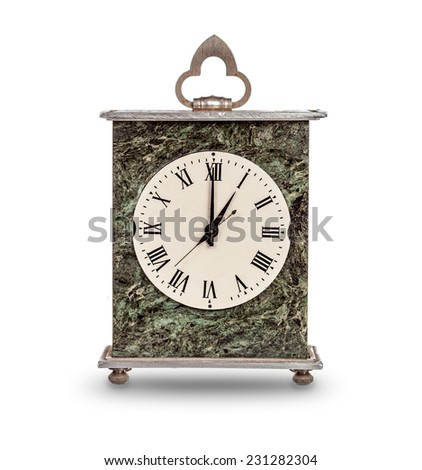 Mantel clock showing one o'clock on white background