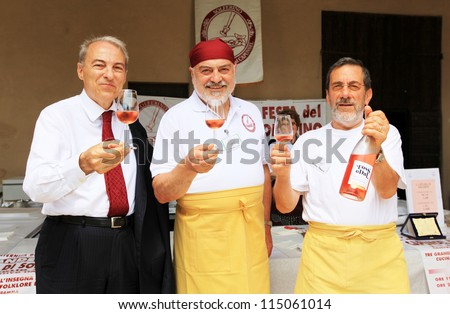 MANTOVA, ITALY - JUNE 13: People tasting wines during Golosaria, fair show of food and gastronomy culture June 13, 2010 in Mantova, Italy. - stock photo