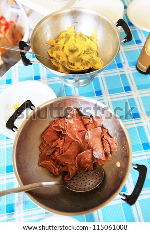 MANTOVA, ITALY - JUNE 13: Tastin cherry and pumpkin hand made tortelli during Golosaria, fair show of food and gastronomy culture June 13, 2010 in Mantova, Italy. - stock photo