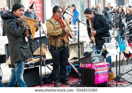 Mantova, Italy - October 30, 2016: Native American musicians playing their traditional music with particular handmade instruments
