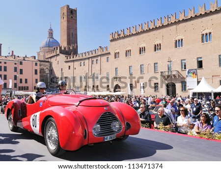 MANTOVA (MN) ITALY - SEPTEMBER 21: Red Simca Huit Deho built in 1938, starts the GP Nuvolari 2012, on September 21, 2012 in Mantova (MN) - stock photo