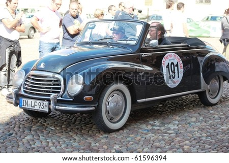 MANTUA, ITALY - SEPTEMBER 19: A 1956 DKW Cabrio parades at Gran Premio Nuvolari in honor of famous Italian car champion Tazio Nuvolari September 19, 2010 in Mantua, Italy.