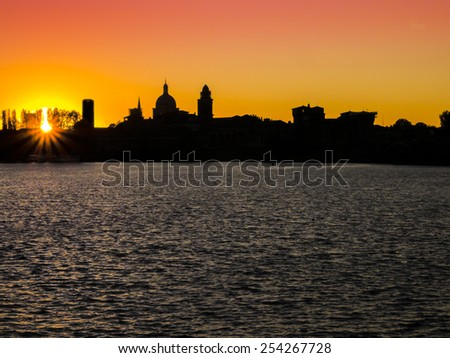 Mantua silhouette at sunset, Italy  - stock photo