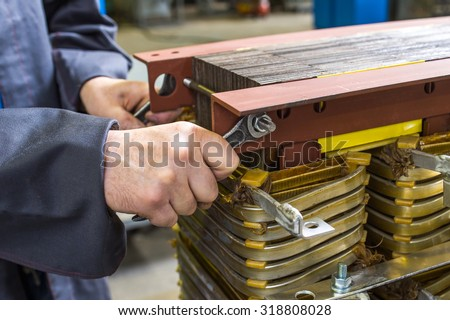 manual assembly of the transformer - stock photo