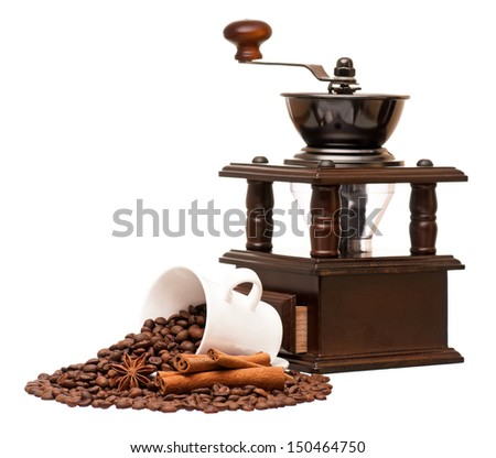 Manual coffee grinder with coffee beans and cup, isolated on white background - stock photo